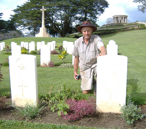 Inspecting his uncle's gravesite at Bomana War Cemetary, Port Moresby