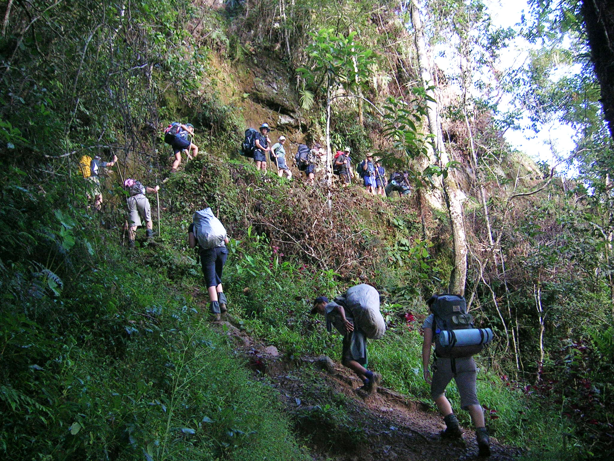 Trekkers heading up a steep and challenging escarpment