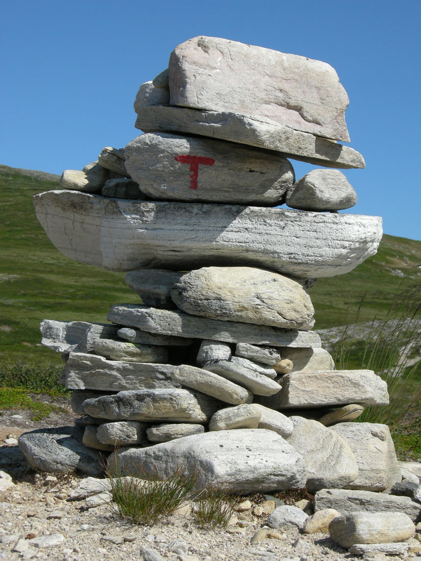 DNT marking cairns are built high with marking designed to be visible even when the ground is covered by snow