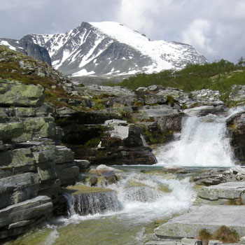 Cascades near Bjornhollia Hut. Rondslottet 2178m, in the background