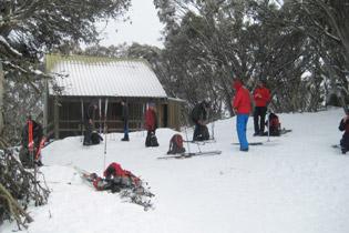 A few ski tourer arriving at the Bluff Spur Hut