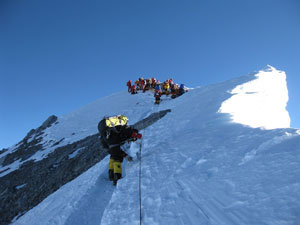 The final 50 metres with climbers on the summit